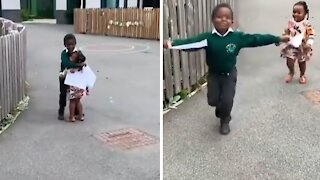 Little girl preciously hugs her big brother after school