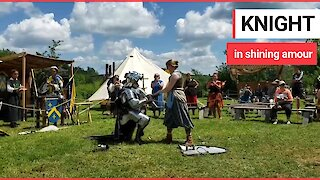 Fantasy-mad 'knight' proposes after challenging his girlfriend to a MEDIEVAL sword fight