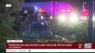 One dead after crash involving car hauler