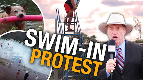 """Residents pass barbed wire fence, hold """"swim-in"""" protest to reclaim Harold Quarry"""
