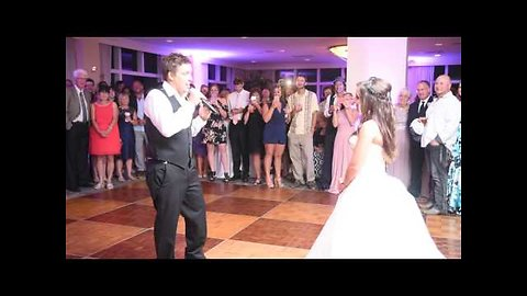 Groom surprises bride with singing performance at reception