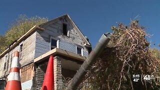 Community helps woman repair home