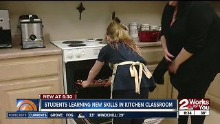 Students learning new skills in kitchen classroom