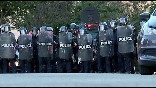 Protesters clash with Detroit police on third night