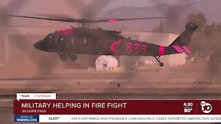Military helping in fire fight