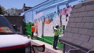 Greeting From East Lansing mural underway