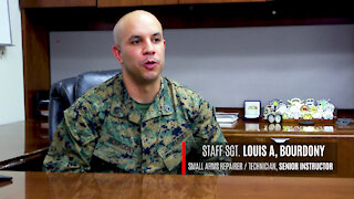 Marine recognized for dedication to students