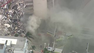 Flames, smoke break out at site of deadly Surfside condo collapse
