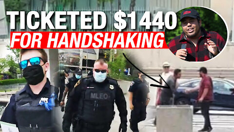 """""""It's a terrible waste of taxpayers money"""": Reporter fined for shaking hands with a protester"""