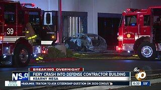 Car crashes into defense contractor building, bursts into flames