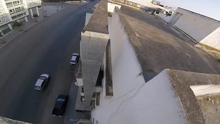 Amazing footage shows death defying parkour run across rooftop