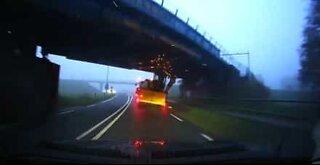 Tractor crashes violently against bridge