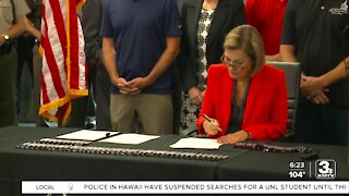 Iowa governor signs measure heightening protest penalties, lawmakers and the ACLU respond