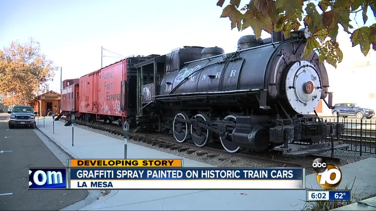 Graffiti painted on historic train cars