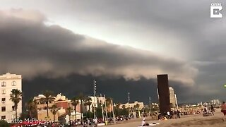 Dramatic Moment Frightening Shelf Cloud Inches Over Crowded Beach