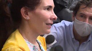 Family member speaks at family reunification center