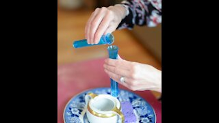 Pouring Water with test tubes - Common Sense Montessori