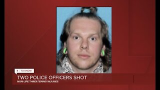 Suspect accused of shooting 2 police officers identified