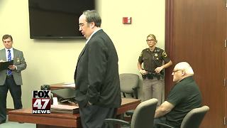 Michigan priest's embezzlement trial delayed