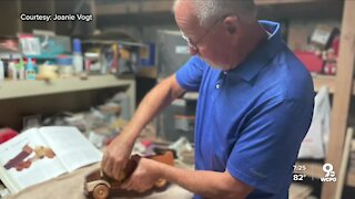Cancer survivor inspires others by crafting wooden trucks that 'dump' the disease