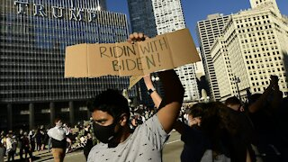 Americans Take To The Streets In Celebration, Protest After Biden Win