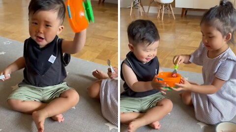 Sister shares her last strawberry with baby brother