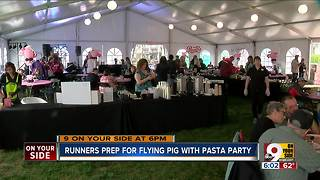 Runners pig out on pasta before Flying Pig Marathon