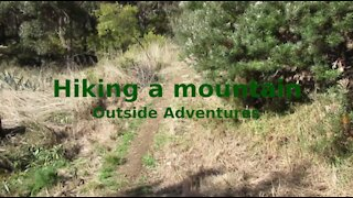 Hiking a mountain: Outside Adventures