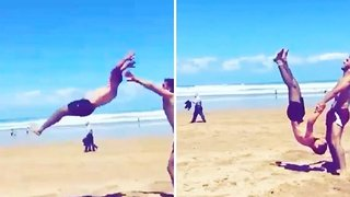 Talented man flips into his friend's hands and then does a backflip