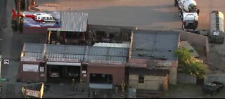 Auto repair shop catches fire