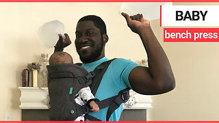 Gym mad dad uses his newborn son as weights