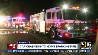 Car crashes into home sparking fire