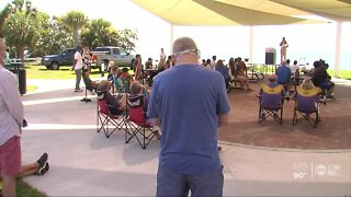 Several people gathered at Waterfront Park for prayer