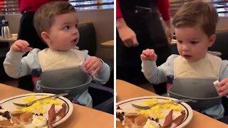 Kid totally freezes when waitstaff sings 'happy birthday' to him