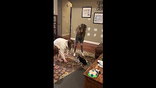 Watch these little girls teach this puppy how to jump