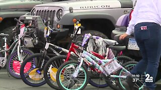 Black Jeepers of the DMV pass out bikes to kids in public housing