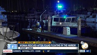 Woman found floating in harbor rescued