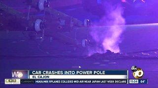 Car crashes into power pole