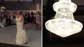 AWKWARD MOMENT BRIDE ACCIDENTALLY THROWS WEDDING BOUQUET INTO CHANDELIER