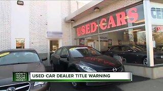 Used car dealer title warning