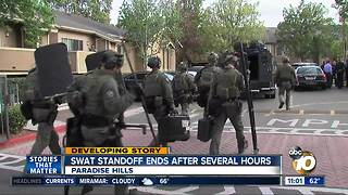 SWAT standoff ends after hours