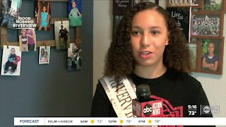 Riverview beauty queen and quarterback works to help community