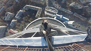 URBAN EXPLORER BRAVELY HANGS FROM THE TALLEST BUILDING IN UKRAINE
