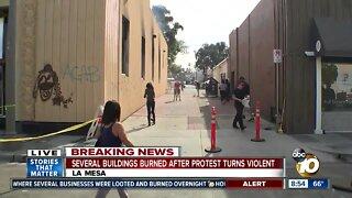 Cleanup begins after protest turns violent, several buildings burn