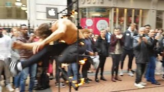 Blindfolded man jumps through a ring of fire!