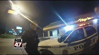 Woman steels police car