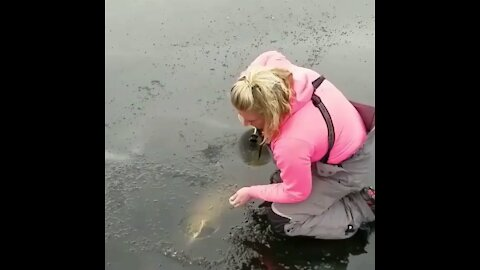 Big Fish hunter woman