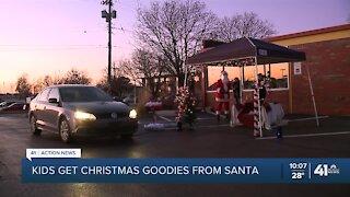 Kids get Christmas goodies from Santa