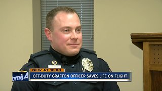 Grafton Police officer saves young woman's life on flight from Florida to Chicago