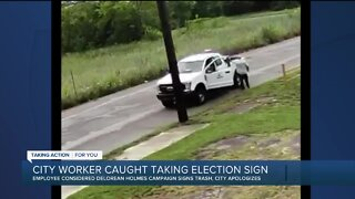 Detroit city worker caught taking election sign